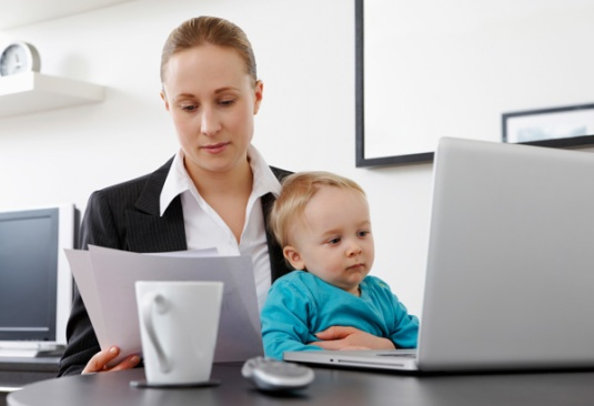 woman at work with baby